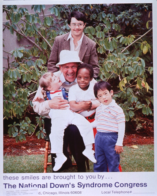 <p>Multicolor poster with blue lettering.  Visual image dominates poster.  Image is a reproduction of a color photo featuring the actor Jack Klugman surrounded by three children and an adolescent with Down syndrome, in an outdoor setting.  Title below image.  Original publisher information covered by an address label with the Park Ridge, Ill. address.</p>