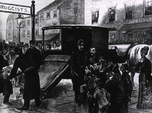 <p>A city ambulance.  Street scene, with &quot;Druggists&quot; sign in left foreground.</p>