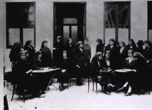 <p>Showing many nurses gathered around tables outside the Public Health Nurses' Home.</p>