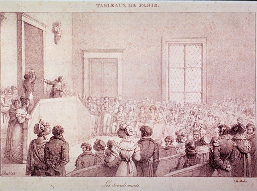 <p>Interior of a large meeting hall filled with people.</p>