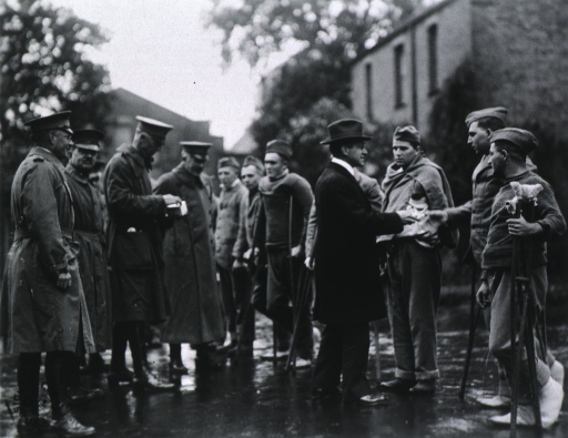 <p>Secretary Baker, General John Biddle, and others greet patients at Base Hospital no. 37, Dartford, England.</p>