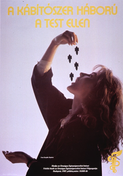 <p>Multicolor poster with yellow and white lettering.  Title at top of poster.  Visual image is a color photo reproduction featuring a young woman.  Her head is tilted back as she drops pills that become little bombs from her hand to her mouth.  Publisher information at bottom of poster.</p>
