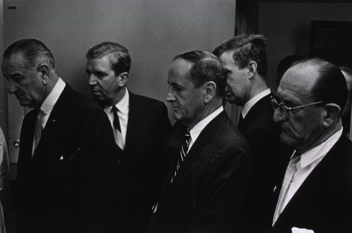 <p>President Johnson listens to Dr. Davidson explain new medical equipment.  John W. Gardner and Jack Masur are among others shown.</p>