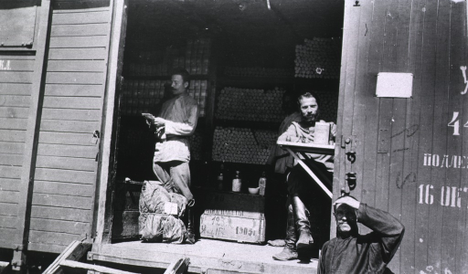 <p>Soldiers(?) checking inventory on a medical supply depot train.</p>
