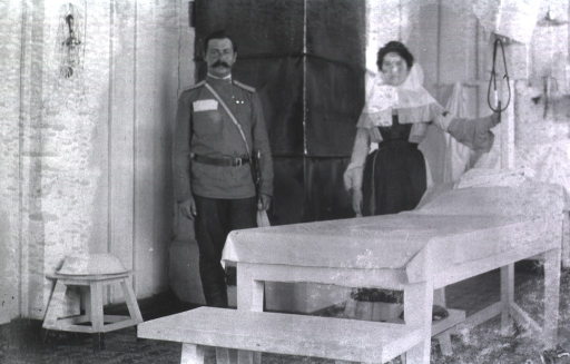<p>A physician and a nurse stand in the Evacuation Commission Hospital.</p>