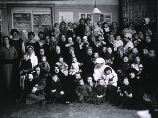 <p>Showing children and attendants gathered for a group photo at the center.</p>