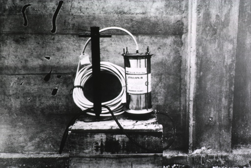 <p>View of Zyklon-B (hydrogen cyanide) canister and hose.</p>