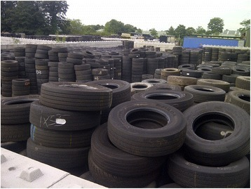 Photograph of used tyres stored at a retreaded tyre manufacturer