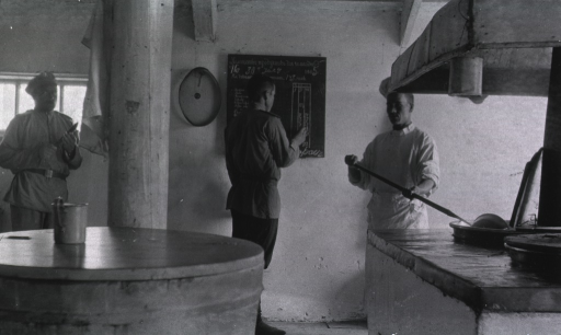 <p>Three kitchen staff workers in the kitchen of Military Hospital No. 16.</p>