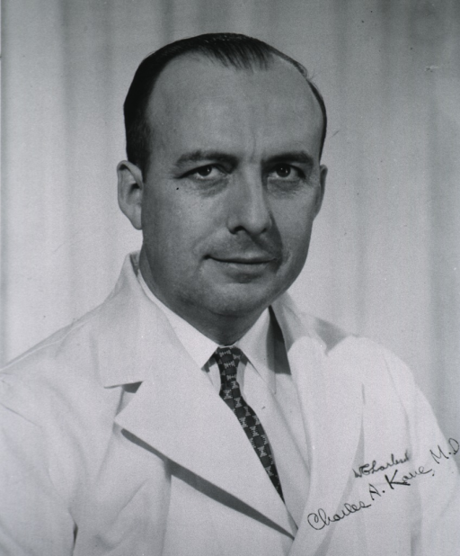 <p>Head and shoulders, right pose, full face; wearing white coat.</p>