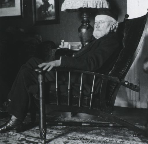 <p>Full length, seated in chair, left pose.</p>