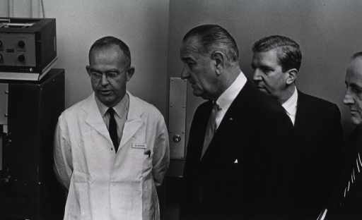 <p>Dr. Davidson explains the latest computer technology to President Johnson.</p>