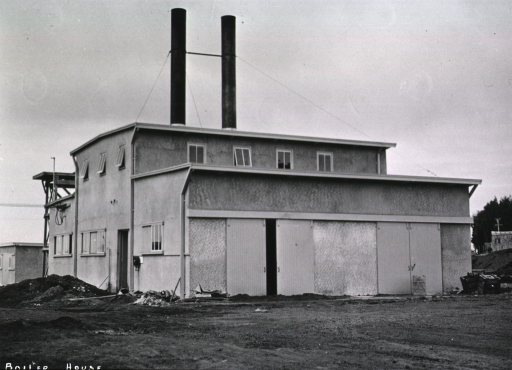 <p>Side view of two-story boiler house serving an undentified military base/hospital.  (One of a series of nine photographs by Breckon of the same unidentified military base/hospital.)</p>