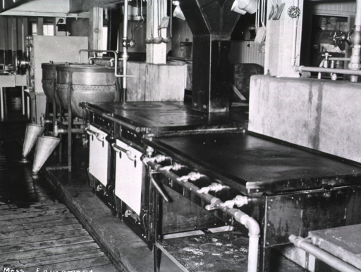 <p>Interior view of a kitchen serving an unidentified military base/hospital.  (One of a series of nine photographs by Breckon of the same unidentified military base/hospital.)</p>