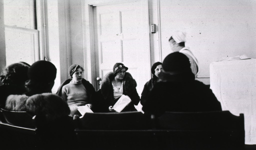 <p>A student nurse conducts a class for mothers.</p>