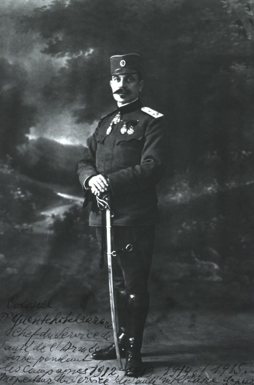 <p>Full length, standing, left pose, hands on sword; wearing uniform (Colonel, Serbian Army).</p>
