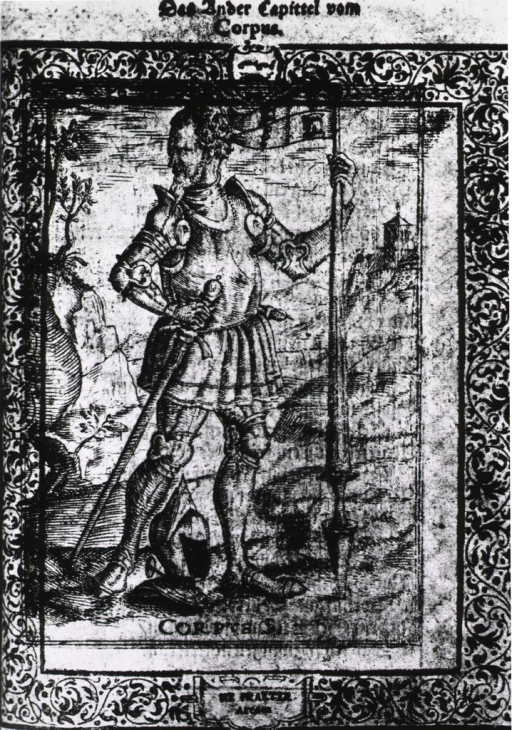 <p>A man is standing full length wearing armor, he is holding a lance in his left hand, his right hand is on a sword; a helmet on the ground at his feet.</p>