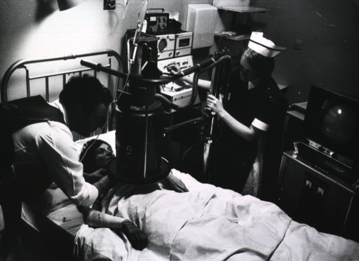 <p>A physician is using an radiography to track the movement of a pacemaker being inserted in a patient's heart. The patient is lying on a bed and a technician is monitoring the x-ray equipment.</p>