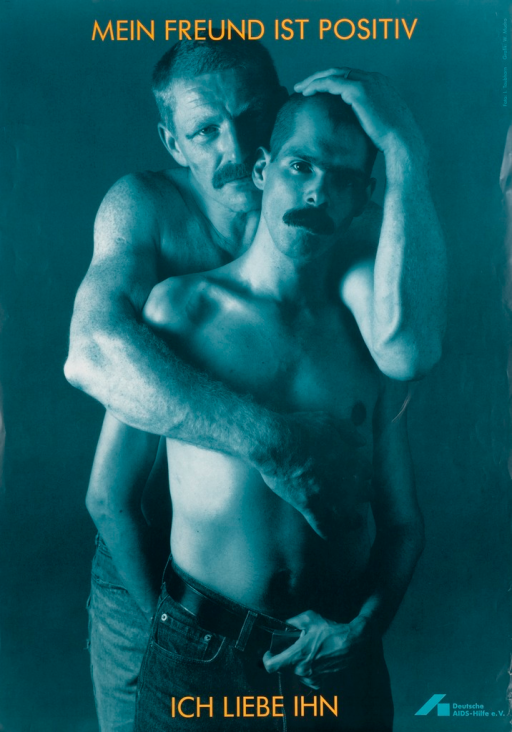 <p>Predominantly blue-tone poster with orange and blue lettering.  Title at top of poster.  Visual image is a photo reproduction featuring a male-male couple in an embrace.  Caption and publisher information at bottom of poster.  Caption professes love for the friend.</p>