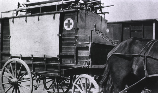 <p>An angled view of the front and side of a Russian wagon ambulance.</p>