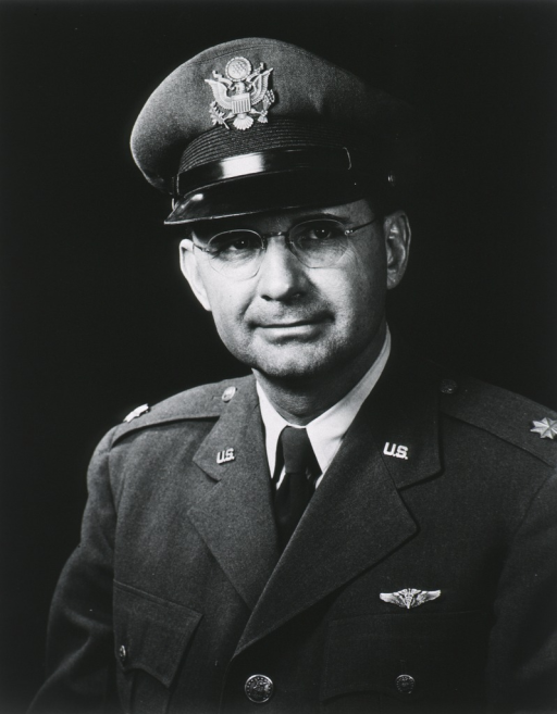 <p>Head and shoulders, full face, uniform, cap, flight surgeon insignia, major.</p>