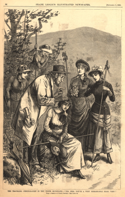 <p>A woman sits on a rock while a man wearing a hat touches her head.  Four women stand by and watch the examination.</p>