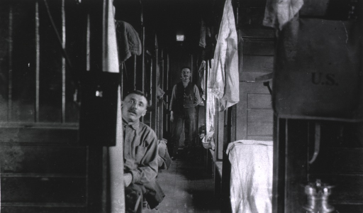 <p>Two soldiers(?) in a hospital railroad freight car used as a ward.</p>