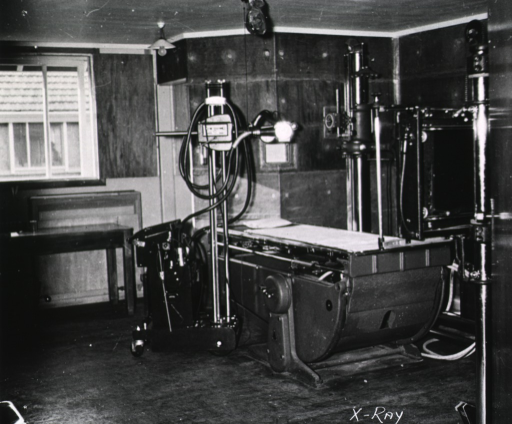 <p>An X-ray machine stands in the corner of a room in an unidentified military base/hospital.  (One of a series of nine photographs by Breckon of the same unidentified military base/hospital.)</p>