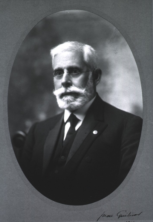 <p>Head and shoulders, left pose, full face; wearing suit; in oval.</p>