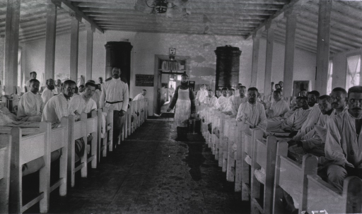 <p>Two medical personnel and male patients in a ward at Military Hospital No. 15.</p>