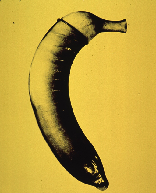 <p>Bright yellow poster.  Visual image is a b&amp;w photo reproduction featuring a banana sheathed in a condom.  No text.</p>