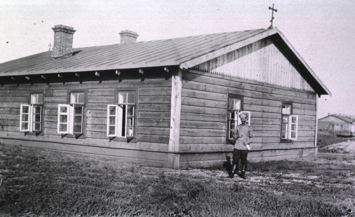 <p>A soldier(?) stands outside the mortuary of the Evacuation Commission Hospital.</p>