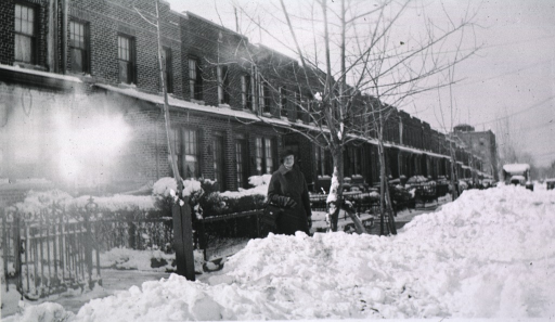 <p>Showing Mrs. Trumper in front of the patients home.  Snow is on the ground.</p>