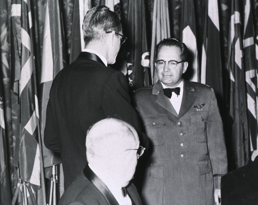 <p>Three quarter length, full face, being congratulated by Mr. Blades (back to camera) on winning the Gorgas Medal.</p>