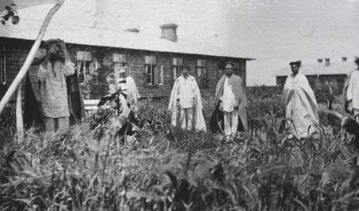 <p>Patients standing outside of a ward.</p>