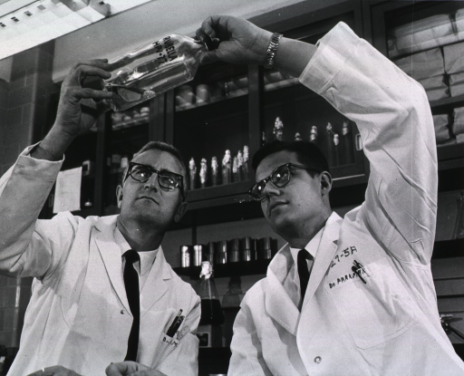 <p>NIH scientists, Dr. Harry Meyer, Jr. and Dr. Paul Parkman, developers of the Meyer-Parkman vaccine, inspect a culture of the virus used in preparing the vaccine.</p>