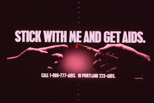 <p>Predominantly black poster with white lettering.  Title at top of poster.  Visual image is a b&amp;w photo reproduction featuring one hand reaching out to accept a syringe from another hand.  A red droplet is superimposed on the tip of the needle.  Numbers for AIDS hotlines at bottom of poster.  Publisher information in lower right corner.</p>