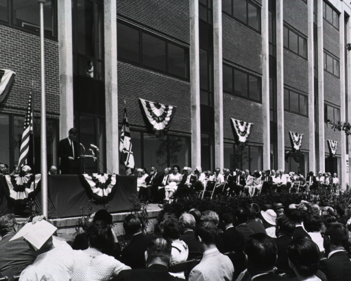 <p>Shows Dr. Philip Lee addressing those gathered for the dedication.</p>