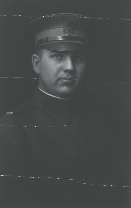 <p>Seated, right.  In uniform.</p>