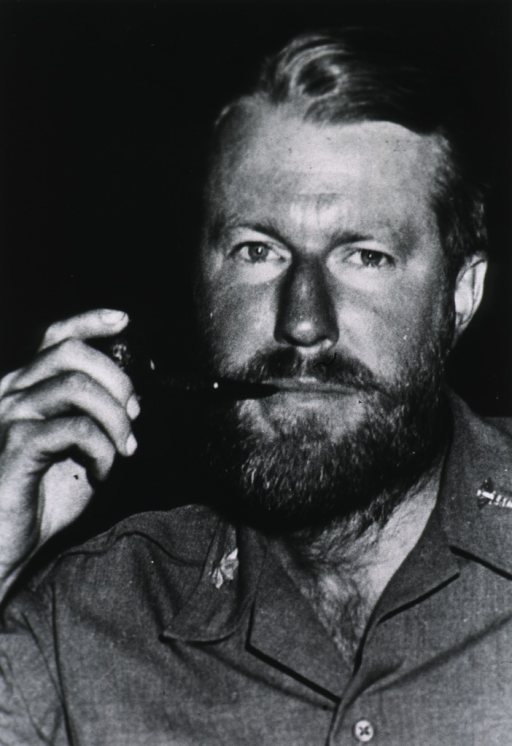 <p>Head and shoulders, full face, beard, wearing Army uniform, smoking a pipe.</p>