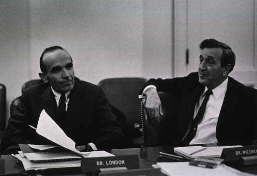 <p>Shows Dr. Irvin M. London and Dr. Jerome B. Wiesner seated at the conference table]</p>