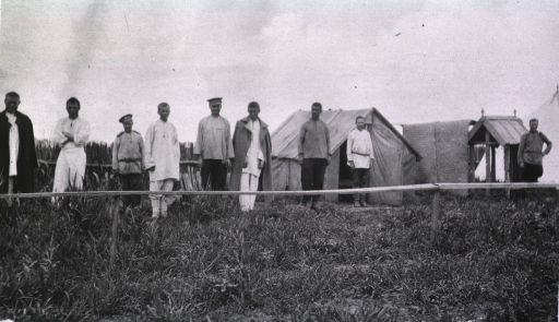 <p>Several smallpox patients standing outside tents at Military Hospital No. 45, an isolation hospital.</p>