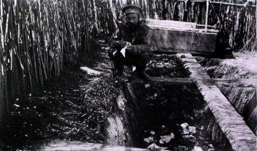 <p>A soldier uses an outside latrine.</p>