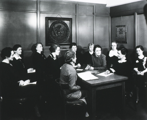 <p>Showing the staff members gathered in the National Organization for Public Health Nursing office in 1937.</p>