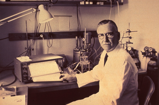 <p>Half-length, seated in laboratory, left pose, full face; wearing glasses and whith lab coat.</p>