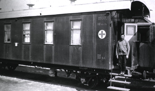 <p>Three soldiers(?), two sitting and one lying down, in a ward aboard hospital military train No. 17.</p>