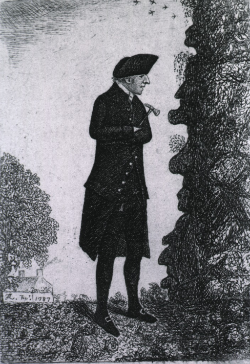 <p>Standing full length in right profile, wearing hat and coat, holding hammer and examining rock formations.</p>