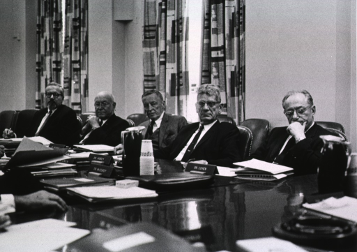 <p>Shows Dr. V.G. Neilsen, Dr. Wendell M. Stanley, Dr. Woodhall, Dr. Maurice J. Hickey, and Dr. Philip P. Cohen seated at the conference table.</p>