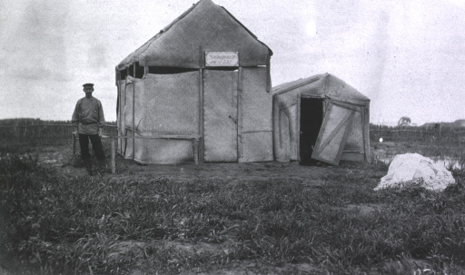 <p>A soldier(?) stands outside the disinfecting house at Military Hospital No. 45, an isolation hospital.</p>