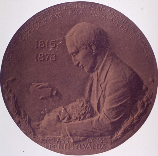 <p>Reproduction of bronze medallion, showing Long administering ether.</p>